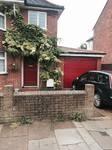 Ruby Red Hormann M ribbed LPU40 insulated sectional door installed in Aylesbury, Thame Garage Doors - Your Local Garage Door Expert